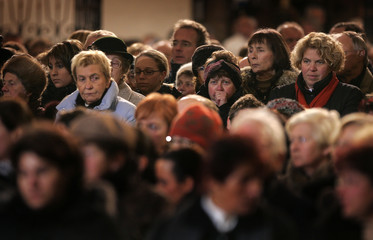 People attend a memorial service for the victims of the collapsed ice rink in Bad Reichenhall
