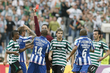 Referee shows red card to Porto's Paulo during Portuguese Cup final against Sporting in Lisbon
