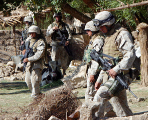 U.S. MARINES SEARCH FOR WEAPONS DURING EARLY MORNING RAID IN VILLAGE OF TALLA NEAR FALLUJA.