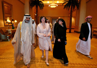 UAE' Education Minister Sheikh Nahayan and wife of Britain's Prime Minister Blair leave a conference in Abu Dhabi