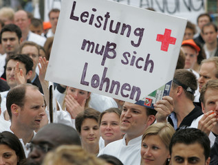 Bavarian hospital doctors protest against low pay and long working hours during a demonstration in Erlangen