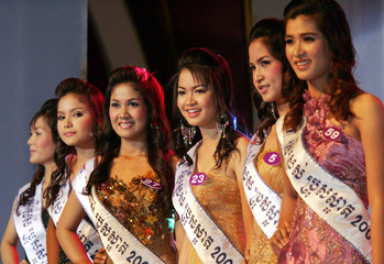 Contestants pose during the Cambodian beauty contest, which roughly translates as 2006 Beautiful Boy and Girl contest, in Phnom Penh
