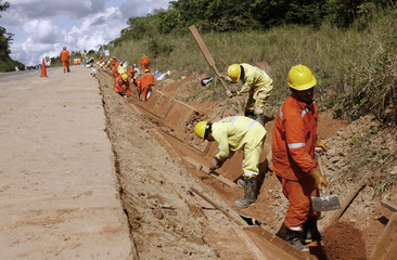 Workers construct the Interoceanic Highway in the Amazon jungle of Madre de Dios