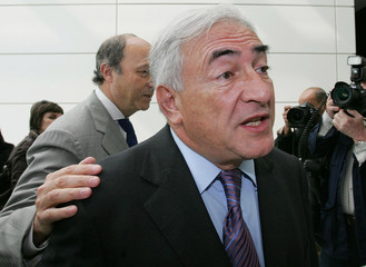 French socialist Fabius is seen near Former Minister Strauss Kahn during a socialist meeting in Bordeaux