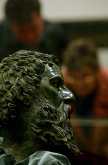 Visitors look at a fourth century BC bronze head of the Thracian King Seth III in the town of Kazanlak.