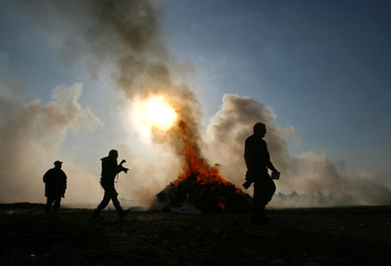 Over seven tons of seized drugs burn on the outskirts of Kabul.