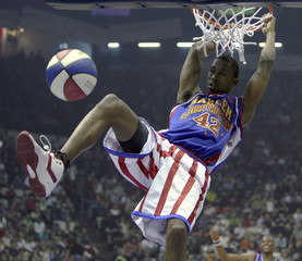Robert Turner of Harlem Globetrotters slams dunk during game with NY Nationals in Istanbul