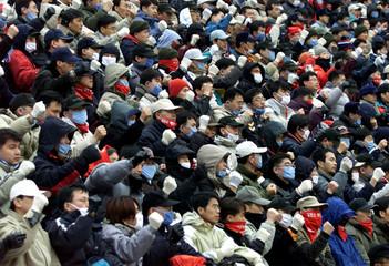STRIKING WORKERS CHANT SLOGANS IN SEOUL.