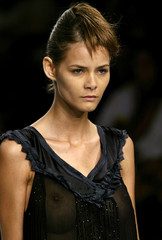 A model wears a creation from Drosofila's 2006 autumn/winter collection during Fashion Rio Show in R..