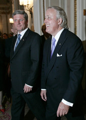 Canada's PM Harper and former PM Mulroney arrive for a dinner in Ottawa