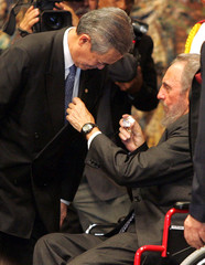 Malaysian Prime Minister Abdullah Ahmad Badawi being awarded by Cuban President Castro.