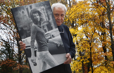 Hollywood paparazzo Galella holds image of Jacqueline Kennedy Onassis at his home in New Jersey