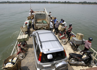 A ferry makes its way across Mekong river in Kamdal province on outskirts of Phnom Penh
