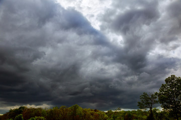 Dramatic sky. White clouds and thunderclouds.