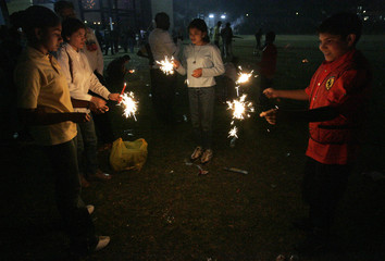 Children play with fireworks in downtown Nairobi during the Hindu festival of Diwali