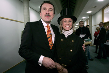 Juettner, Social Democratic challenger of Lower Saxony federal state Prime Minister Christian Wulff, poses with chimney sweeper Verena Szwalkiewicz in Hanover