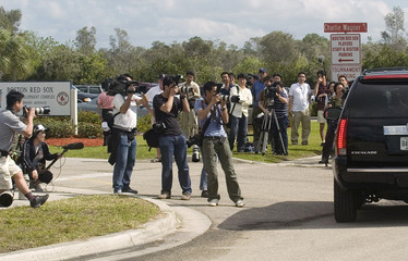 Journalists photograph the arrival of Boston Red Sox pitcher Daisuke Matsuzaka outside the team's Player Development Complex in Fort Myers