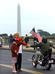 WOMAN SLAPS HANDS WITH BIKER DURING ROLLING THUNDER PARADE INWASHINGTON.