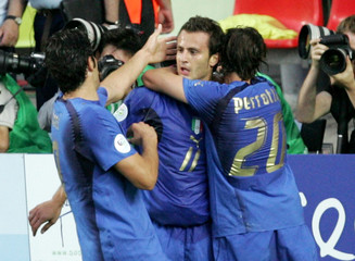 Italy's Gilardino celebrates his goal against the US with team mates Toni and Pirlo during their Group E World Cup 2006 soccer match in Kaiserslautern
