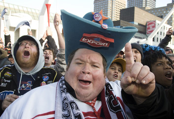 Montreal Alouettes' fans cheer during victory parade in Montreal