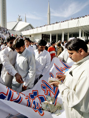 Pakistani Muslims collect funds for earthquake victims after last Friday prayer of Islamic holy month of Ramadan in Islamabad