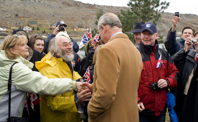Britain's Prince Charles is greeted by residents on the second day of his tour of Canada, in Cupids