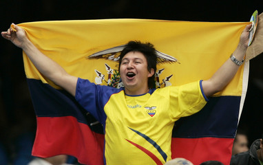 An Ecuador fan awaits the start of the gold medal match between Ecuador and Jamaica in the men's soccer competition at the Pan American Games in Rio de Janeiro