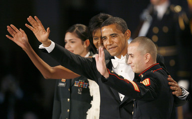 US President Obama and first lady Michelle Obama wave at the Commander-in-Chief Ball in Washington