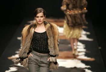 A model shows a design by Julien MacDonald during London Fashion Week.
