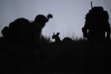 US soldiers walk during a security operation for the Afghan elections near Honaker Miracle camp at the Pesh valley of Kunar Province