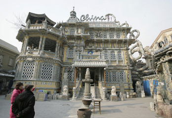 "Visitors look at the ""China House"" in Tianjin"