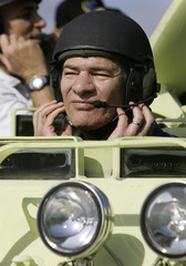 European Space Agency astronaut Nespoli of Italy adjusts his helmet while getting ready to practice driving an M113 tank during launch dress rehearsal activities at the Kennedy Space Center in Cape Canaveral, Florida