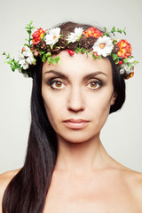 Pretty woman with spring flower wreath