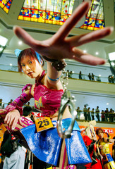 GIRL DRESSED AS JAPANESE COMIC FIGURE PERFORMS IN HONG KONG.