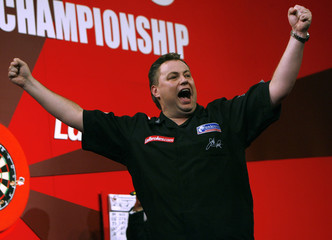 Canada's John Part reacts after beating Britain's Kirk Shepherd to win the final of the World Darts Championship at Alexandra Palace in London