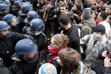 Students are stopped by gendarmes as they demonstrate near the Sorbonne university in Paris