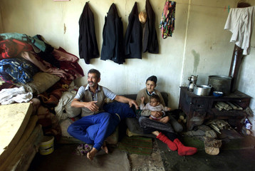 Kosovo Roma family members sit in their room at a camp in Plemetina, a village about 10 kilometres n..