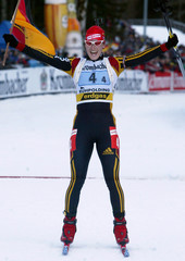 GERMANY'S WILHELM CELEBRATES HER TEAM'S VICTORY OF 4X6 KILOMETERS RELAY COMPETITION AT BIATHLON ...