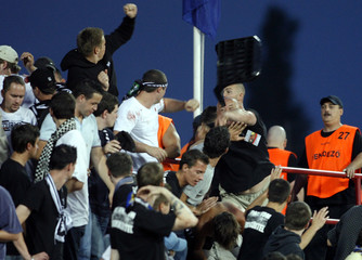 Sturm Graz fans clash with stewards during their Intertoto soccer match against Honved FC