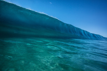 Big ocean wave in pipeline shape rising. Sea water ready to break