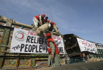 Workers load relief supplies onto a truck at the Pakistan Red Crescent Society in Islamabad