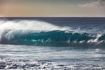 Rip curl rough sea. Water turbulent surface crashing against beach