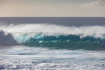 Blue ocean shorebreak wave for surfing sport activity. Template with nobody on background. Tropical summer scenery