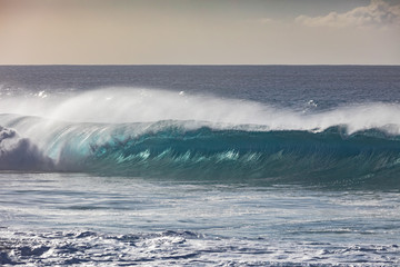 Blue ocean shorebreak wave for surfing sport activity. Template with nobody on background. Tropical summer seascape scenery