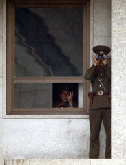 NORTH KOREAN SOLDIERS LOOK AT THE SOUTH AT THE TRUCE VILLAGE OFPANMUNJOM.