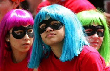 "Fans dressed as U.S. cartoon characters ""The Powerpuff Girls"" watch a match during the second day of.."