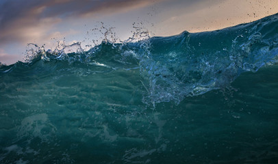 Front view of ocean wave. Sea pattern with Water drops shorebreak verticall wall
