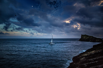 Sail boat in night sea
