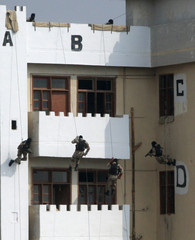 Members of Pakistan Ranger's Anti Terrorist Force show their skills during a demonstration on their passing out parade in Karachi