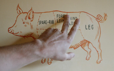 Borut Kozelj points to a picture of a pig during an evening butchery class in London
